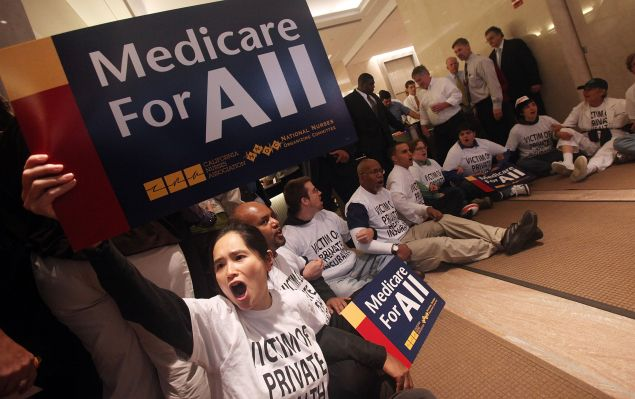 NEW YORK - SEPTEMBER 29: Health care reform supporters participate in a sit-in inside the lobby of a building where Aetna insurance offices are located. The protesters were eventually arrested by NYPD.