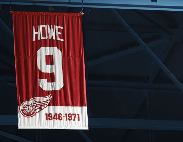 The jersey retirement banner for Gordie Howe #9 of the Detroit Red Wings (1946-1971) hangs in the rafters during a game against the Minnesota Wild on March 11, 2010 at Joe Louis Arena in Detroit, Michigan.