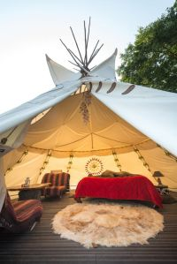 Stay in one of Glamping Hub's accommodations, like this remote and cozy tipi.