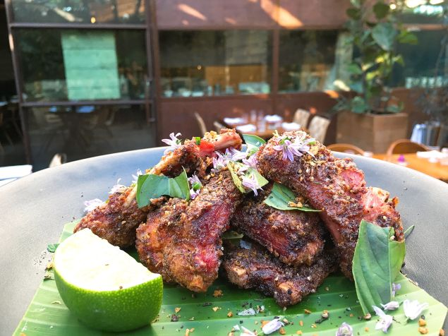 The wild boar ribs at Hinoki & the Bird are dusted with cumin and Szechuan peppercorns.