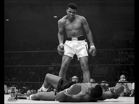Muhammad Ali floors Sonny Liston.