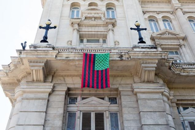 A David Hammons flag piece hanging on the Museo Nacional de Bellas Artes in Havana, Cuba.