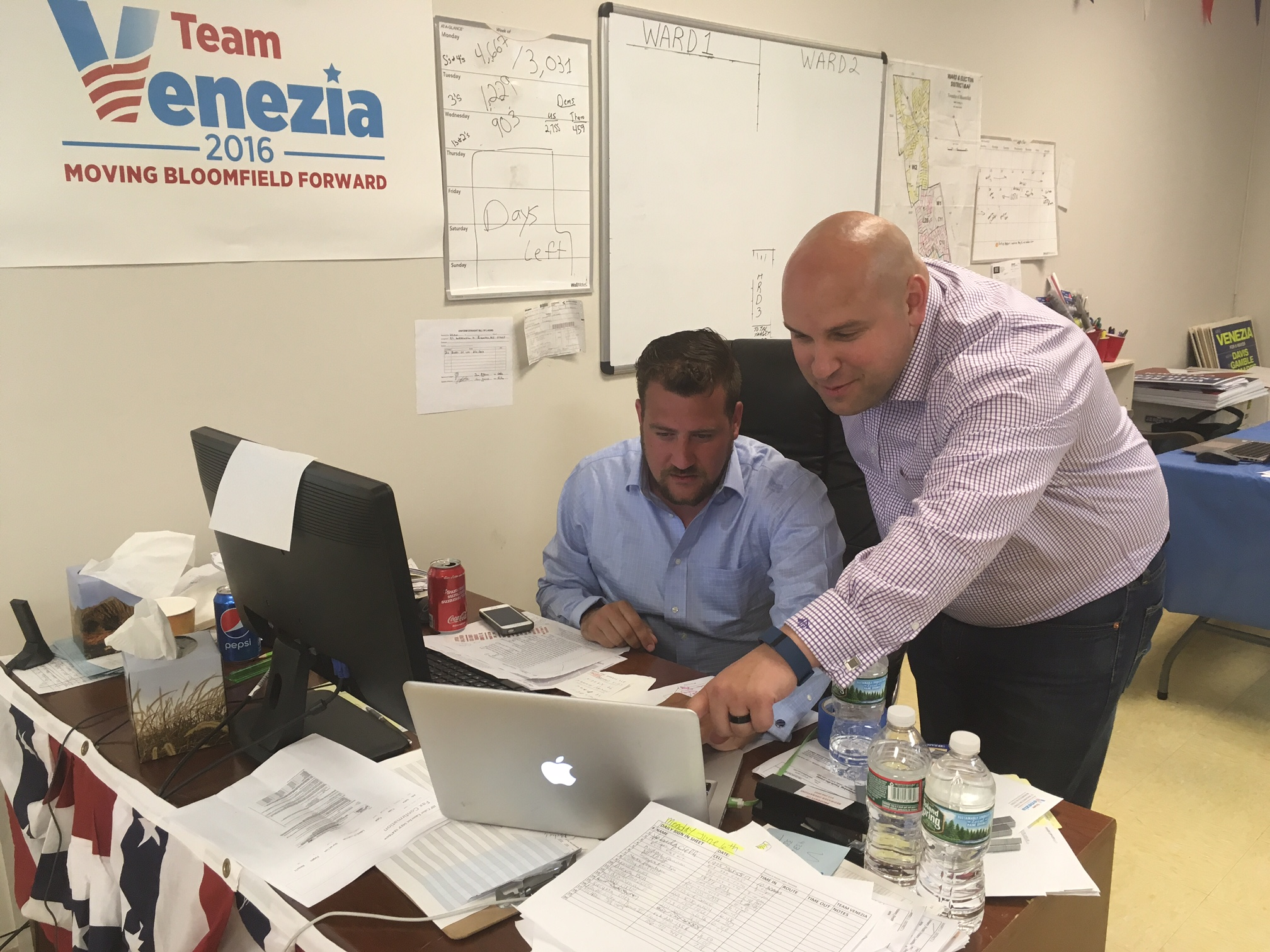 Venezia (right) with campaign staffer Mike DeLamater at the campaign headquarters.