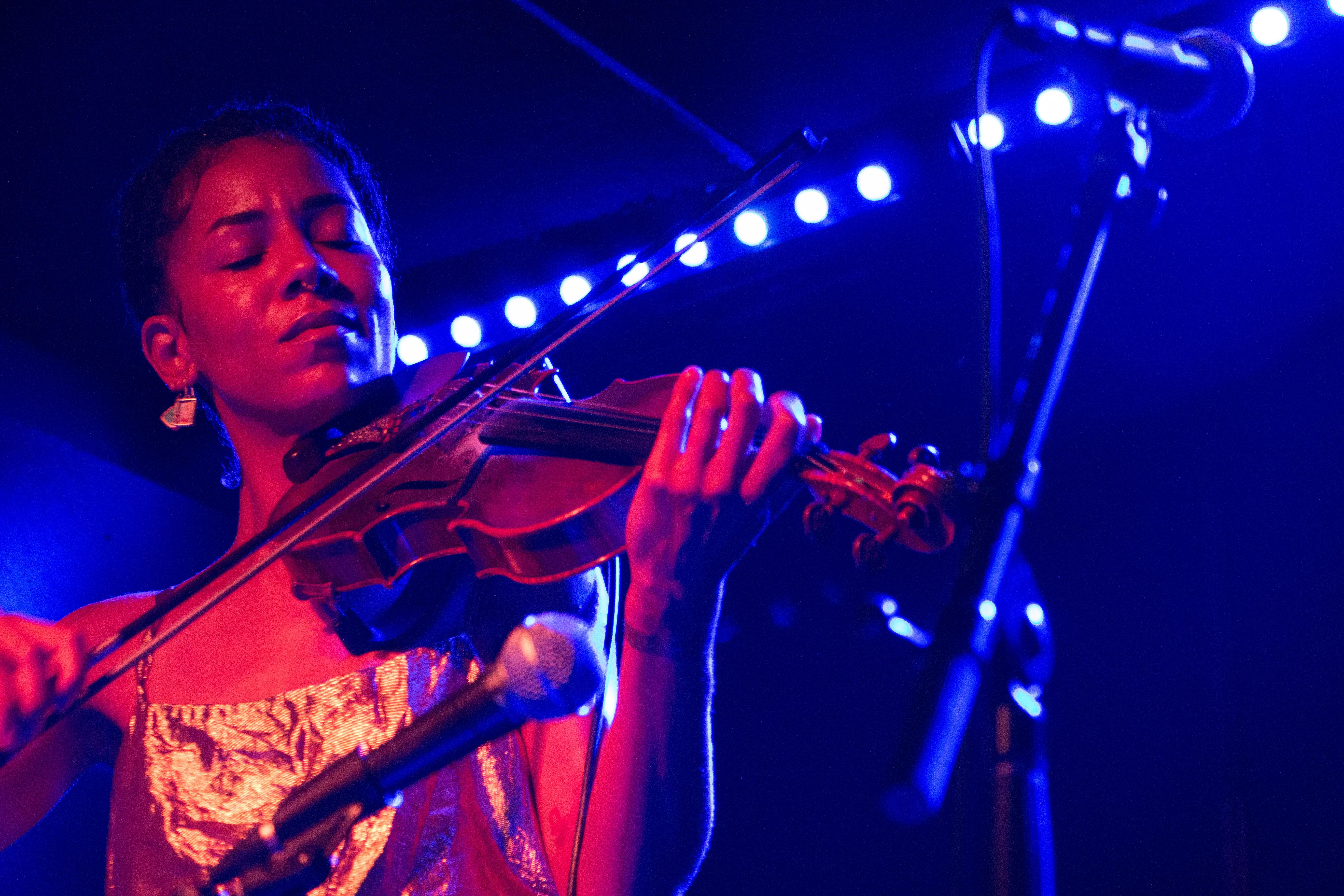 Charles plays her bejeweled violin