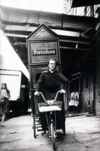 Joey Skaggs as a priest pedals his Portofess.