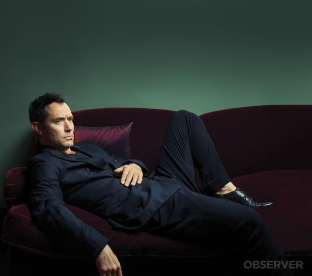 Jude Law reclines at Gramercy Park Hotel.