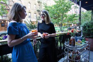 Authors Leslie Pariseau and Talia Baiocchi chat on the veranda at Sessanta.