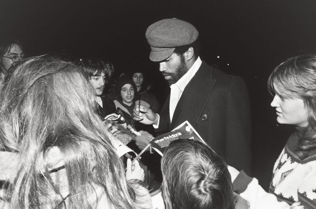 O.J. Simpson signs autographs outside Rich Stadium.