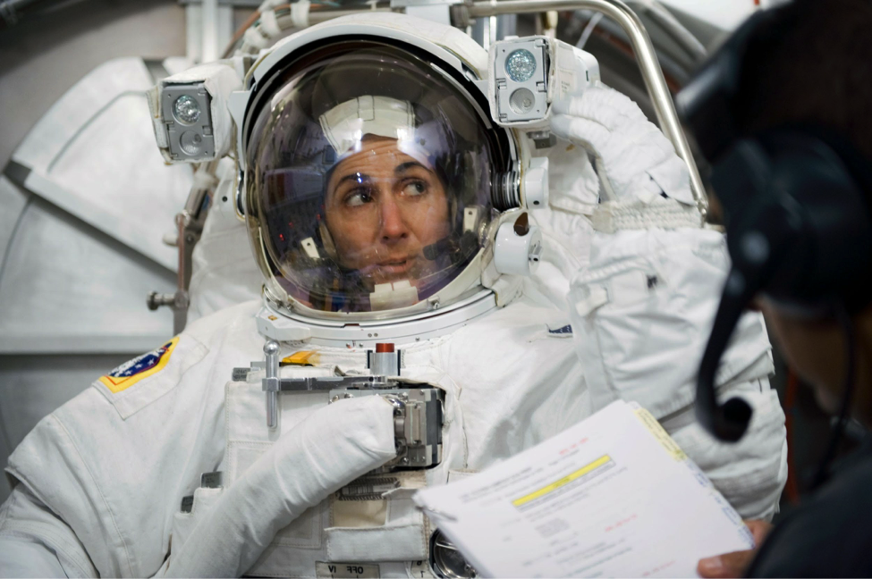 Astronaut Nicole Stott participates in a spacesuit fitting prior to mission that will require a spacewalk