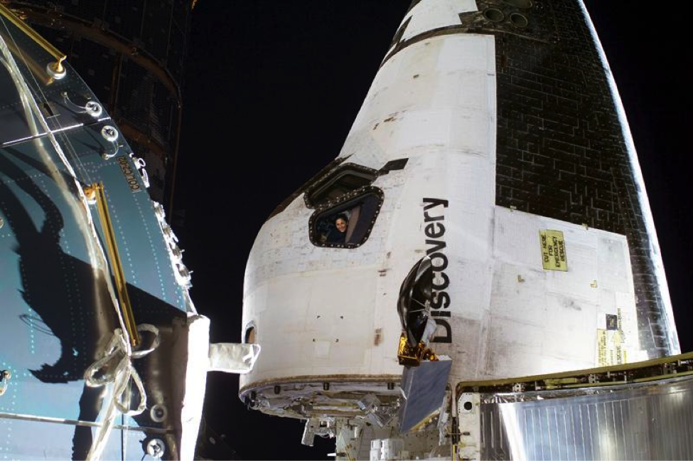 Nicole Stott on board the space shuttle Discovery during STS-133 to the International Space Station.
