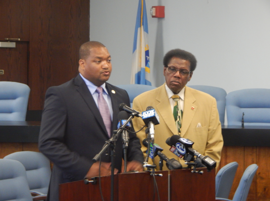 Atlantic City's council president Marty Small (left) announces his plan to cut two at-large council seats in a bid to save money alongside ward councilman Kaleem Shabazz