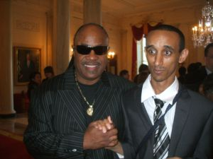 Mussie with Stevie Wonder at the White House