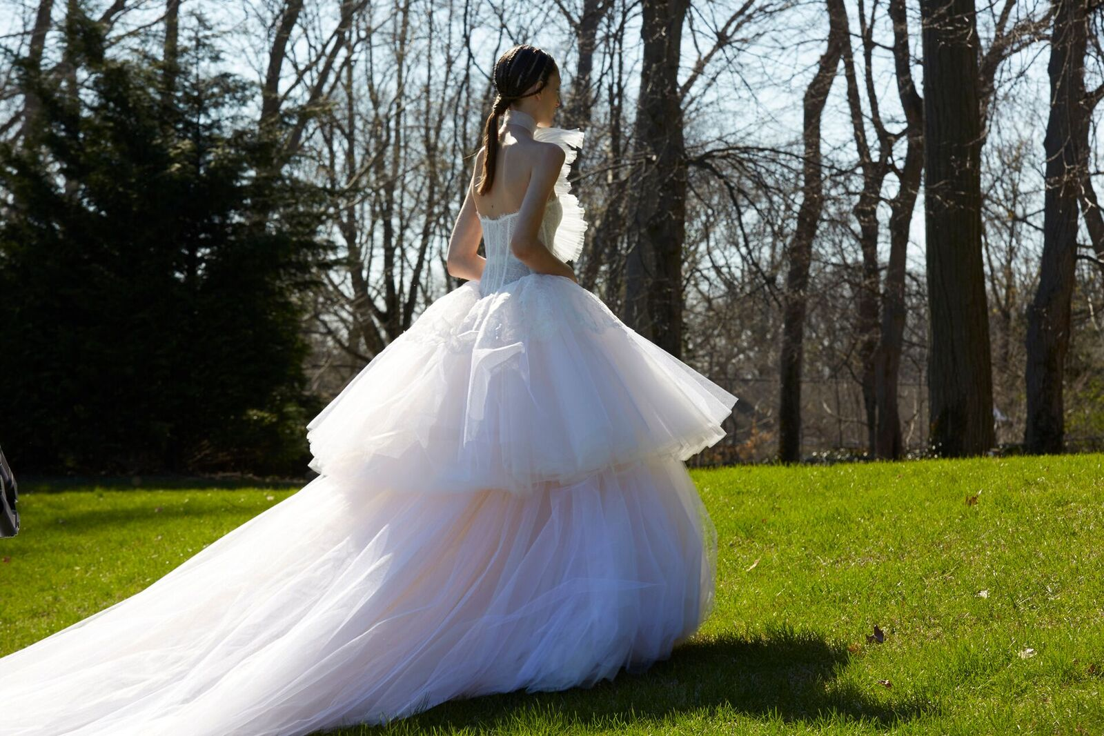THE DRESS: Vera Wang weds fairytale and fashion in a corset bodice that explodes into a cloud of a double-tiered ballgown skirt.