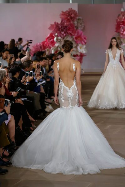 THE DRESS: For the Miami Beach bride intent making a statement, Ines di Santo's sweetheart mermaid gown with a dramatically low illusion back will turn heads coming and going.