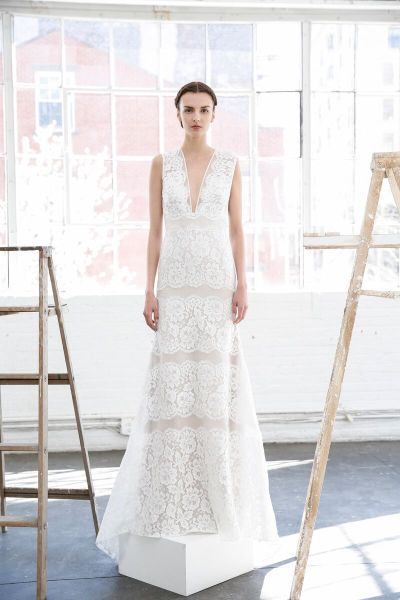 THE DRESS: Crips and clean as a Nantucket sunrise, this organza sheath from Lela Rose teases tradition with its plunging V-neck and generous bands of lace.