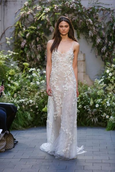 THE DRESS: As effortless as a wedding gown can be, Monique Lhuillier's jeweled Chantilly lace slip dress requires no more than sun-kissed shoulders and a well-toned body. The nude lining keeps it legal.