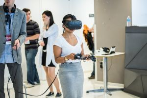 An attendee tries an HTC Vive at Games For Change 2016.