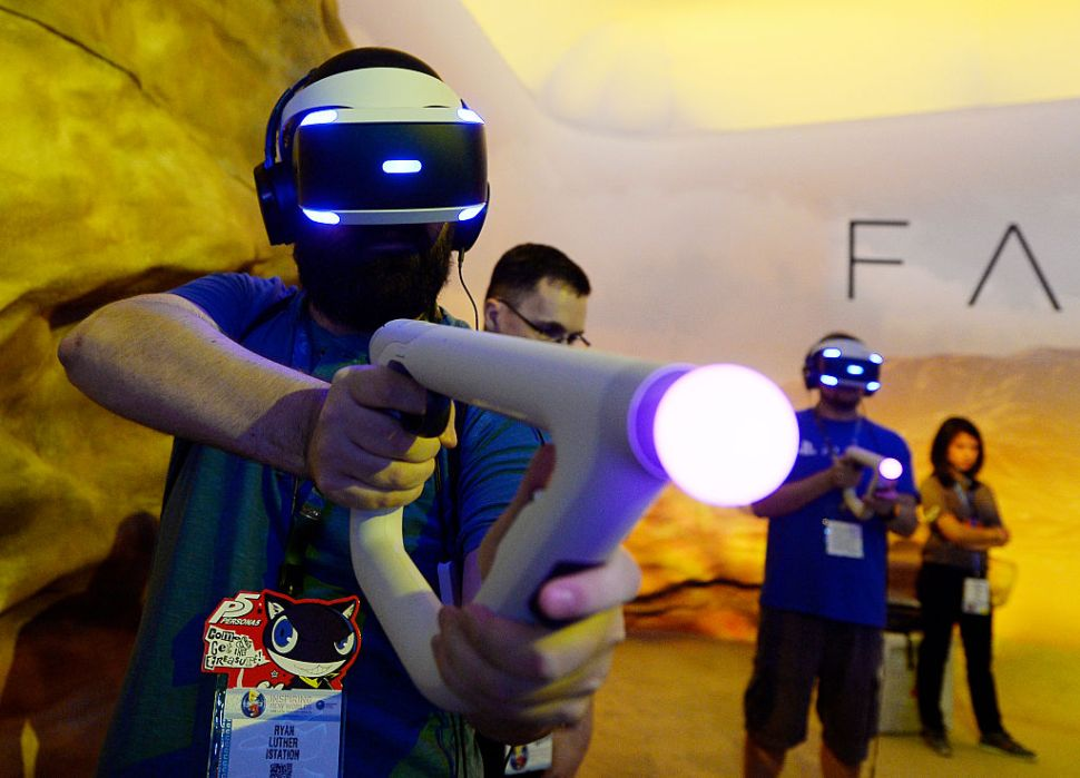 Gamers try out the new Sony VR headset in Sony Playstation booth during the annual E3 2016 gaming conference at the Los Angeles Convention Center on June 14, 2016 in Los Angeles, California. The Electronic Entertainment Expo will run from June 14 -16.