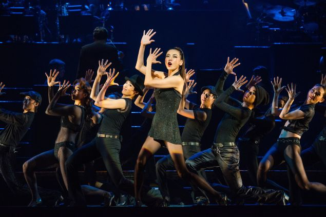 Yoka Wao (forefront) in A scene from Takarazuka in Chicago, music and Lyrics by Kander and Ebb, choreography by Bob Fosse, presented by Lincoln Center Festival at the David H. Koch Theater on July 20, 2016. Performers: Yoga Wao_Velma Kelly (long hair in pony, thin Hikaru Asami_Roxie Hart (short bob hair) Jun Hatsukaze_Matron Mama Morton_older woman with curly hair Saori Mine_Billy Flynn (in pants suit) Yuki Kaon_Fred Casely (in sweater- Husband.
