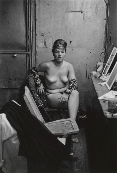 Stripper with bare breasts sitting in her dressing room, Atlantic City, N.J. 1961.