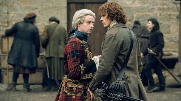 Andrew Gower as Prince Charlie and Sam Heughan as Jamie Fraser in Outlander.