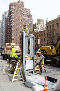 A LinkNYC wifi kiosk going in.