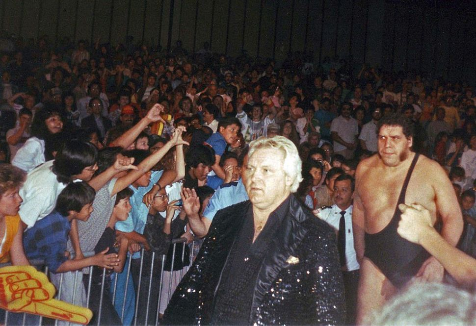 "Bobby ""The Brain"" Heenan leads Andre the Giant to the ring for a WWF bout."