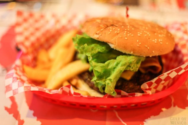 All those cheeseburgers are wreaking havoc on your body's microbes.