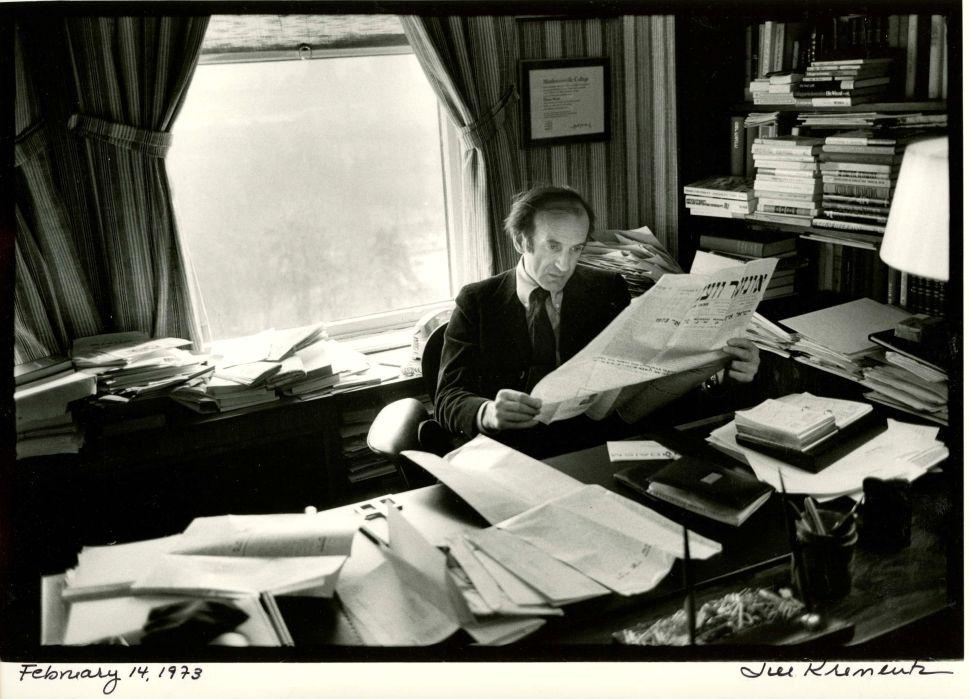 Elie Wiesel photographed by Jill Krementz at his desk on Febraury 14, 1974