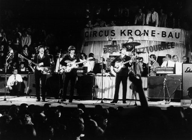 The Beatles performing on stage before thousands at the Circus Krone Bau in Munich.