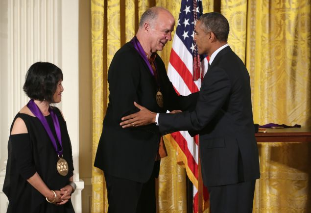 WASHINGTON, DC - JULY 28: U.S. President Barack Obama (R) presents the 2013 National Medal of Arts to Architect Billie Tsien (L) and Tod Williams (2nd L) during an East Room ceremony July 28, 2014 at the White House in Washington, DC. Tsien and Williams were honored for their contributions to architecture and arts education.