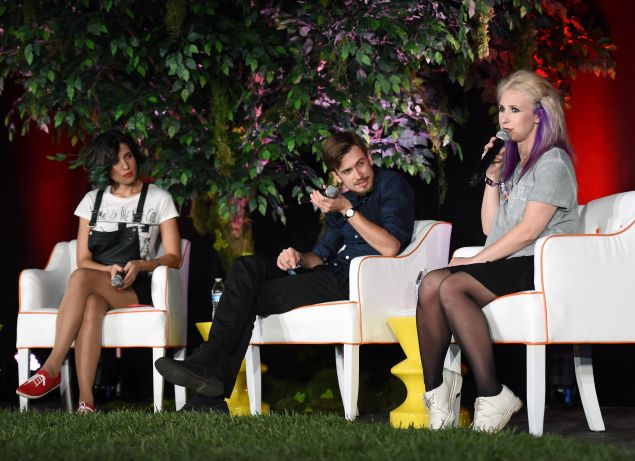 "LAS VEGAS, NV - OCTOBER 24: (L-R) Founding member of the art collective Pussy Riot Nadezhda ""Nadya"" Tolokonnikova, her husband and translator, Pyotr Verzilov and Pussy Riot founding member Maria ""Masha"" Alekhina speak at the Life is Beautiful festival on October 24, 2014 in Las Vegas, Nevada."
