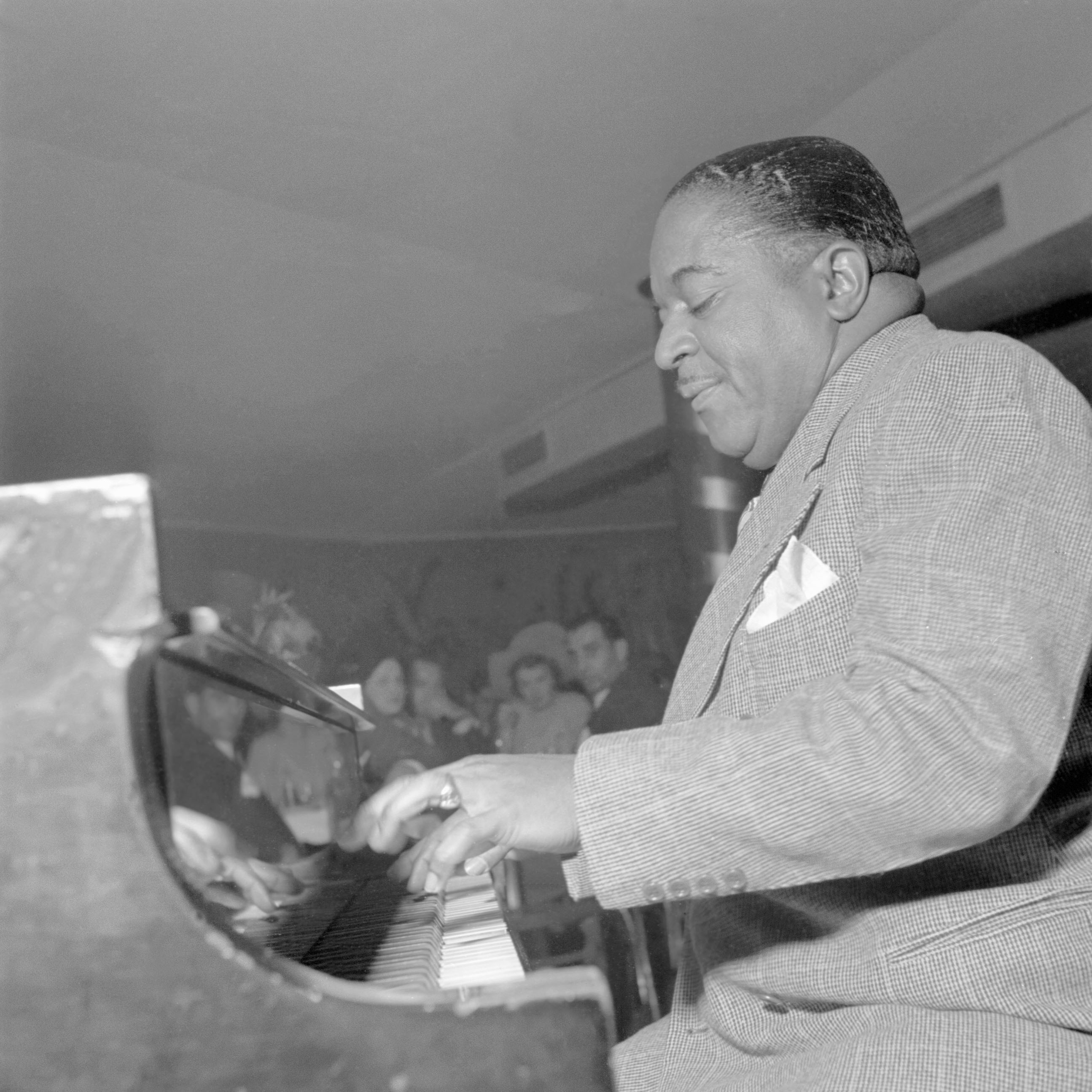 Jazz piano player Pete Johnson plays with his jazz orchestra in a New York City club in the fifties.