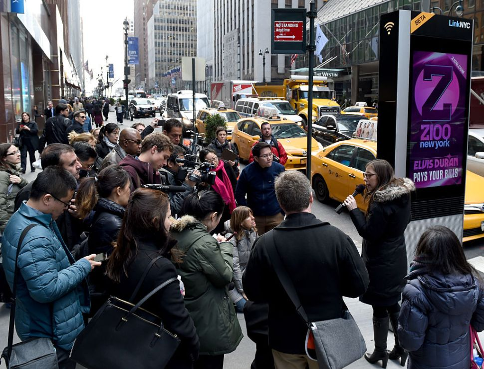 Foreign press are given a tour by the New York Foreign Press Center as they are shown a kiosk on 3rd Avenue introducing LinkNYC, New York Citys Free Superfast Broadband Experiment on March 21,2016. / AFP / Timothy A. CLARY (Photo credit should read TIMOTHY A. CLARY/AFP/Getty Images)