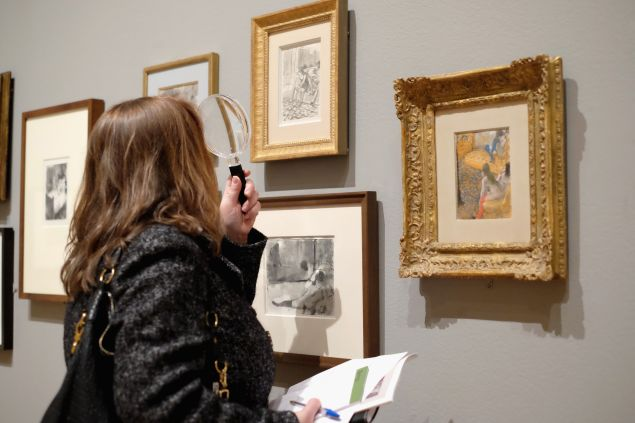 """A guests views artwork by Edgar Degas on display during the """"Edgar Degas: A Strange New Beauty"""""""