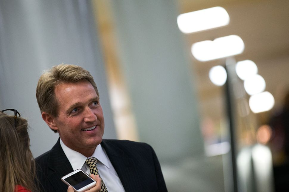 WASHINGTON, DC - MAY 9: Sen. Jeff Flake (R-AZ) speaks with reporters after a vote at the U.S. Capitol, May 9, 2016, in Washington, DC. Senate Democrats defeated a procedural vote on an energy bill, which increases funding for the Department of Energy and Army Corps of Engineers.