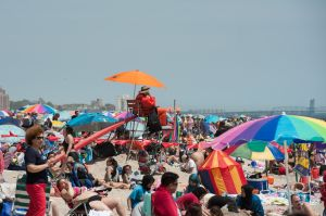 NEW YORK, NY - MAY 29: A life guard watches beach goers in Coney Island on May 29, 2016 in the Brooklyn borough of New York City. New York City is experiencing higher than average temperatures for the holiday weekend. (Photo by Stephanie Keith/Getty Images)