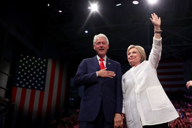 BROOKLYN, NY - JUNE 07: Democratic presidential candidate former Secretary of State Hillary Clinton (R) and her husband former U.S. president Bill Clinton greet supporters during a primary night event on June 7, 2016 in Brooklyn, New York. Hillary Clinton surpassed the number of delegates needed to become the Democratic nominee over rival Bernie Sanders with a win in the New Jersey presidential primary.