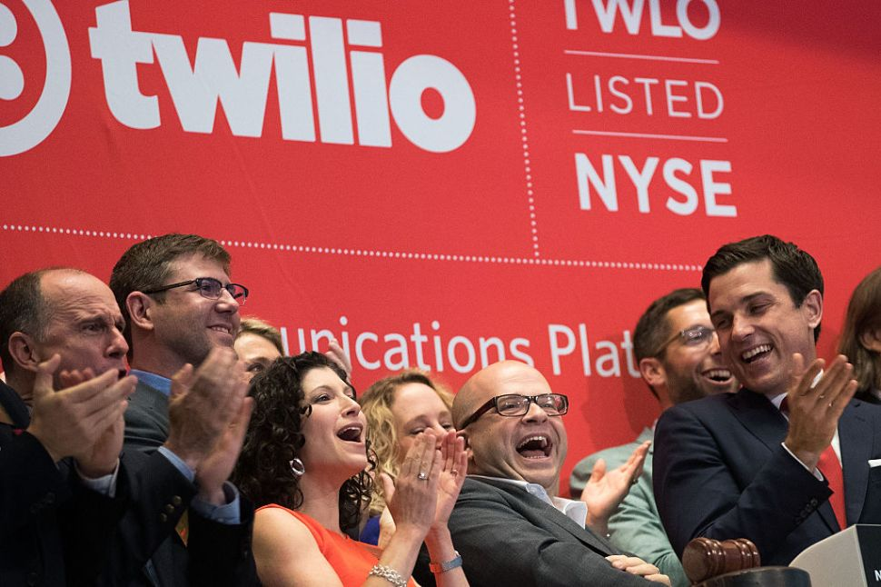 NEW YORK, NY - JUNE 23: Twilio Inc. founder and CEO Jeff Lawson (C, in glasses) reacts after ringing the opening bell to celebrate Twilio's initial public offering, at the New York Stock Exchange, June 23, 2016 in New York City. Financial markets are bracing for the outcome of Thursday's historic 'Brexit' referendum, where Britons will head to the polls to decide whether the United Kingdom should remain in the European Union.