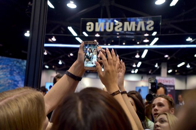 ANAHEIM, CA - JUNE 23: VidCon attendees take a selfie with a Samsung Galaxy S7 at the Samsung Experience At VidCon 2016 on June 23, 2016 in Los Angeles, California.