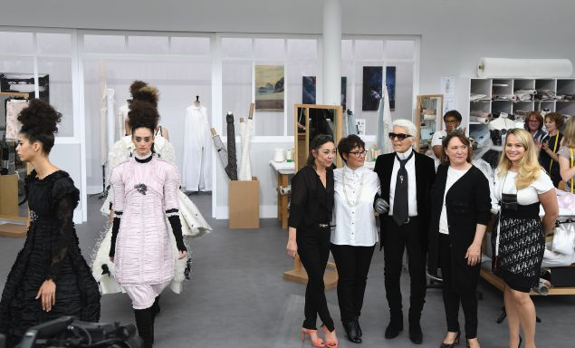 Karl Lagerfeld poses with Chanel's seamstresses