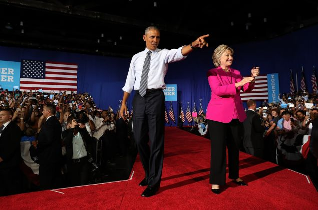 CHARLOTTE, NC - JULY 05: Democratic presidential candidate former Secretary of State Hillary Clinton (R) and U.S. president Barack Obama greet supporters during a campaign rally on July 5, 2016 in Charlotte, North Carolina. Hillary Clinton is campaigning with president Obama in North Carolina.
