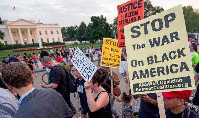Protestors rally outside the White House.