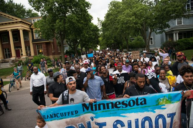 Protestors march through the streets during a demonstration for Philando Castile in St. Paul, Minnesota.