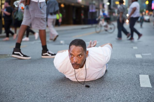 "A man lays on the ground after yelling ""Don't shoot me"" at police during a rally in Dallas, Texas."