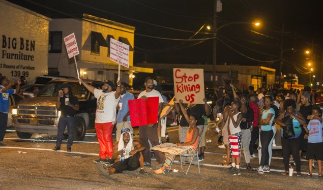 Protesters block the intersection during the third night of protest for Alton Sterling.