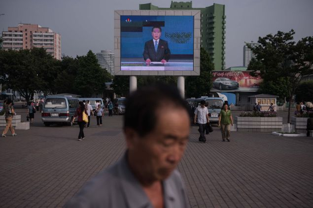 In a photo taken on July 11, 2016, a news broadcast is displayed on a giant screen in Pyongyang. / AFP / Ed Jones