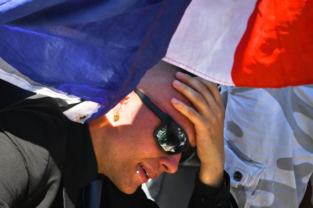 NICE, FRANCE - JULY 15: A man reacts as people visit the scene and lay tributes to the victims of a terror attack on the Promenade des Anglais on July 15, 2016 in Nice, France. A French-Tunisian attacker killed 84 people as he drove a lorry through crowds, gathered to watch a firework display during Bastille Day Celebrations. The attacker then opened fire on people in the crowd before being shot dead by police.