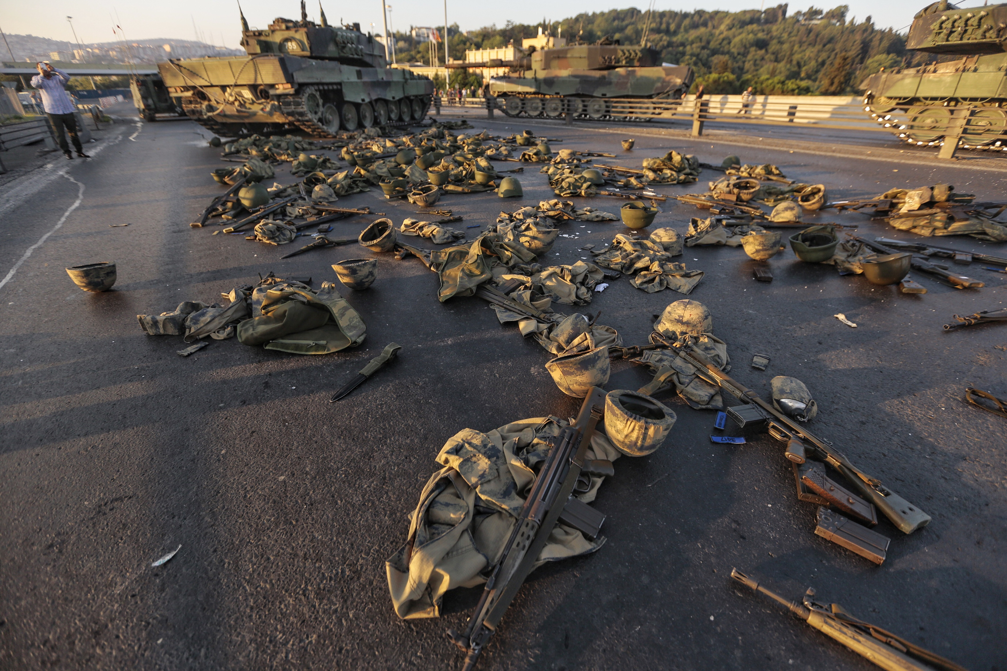 Clothes and weapons belonging to soldiers involved in the coup attempt that have now surrendered lie on the ground abandoned on Bosphorus bridge on July 16, 2016, Istanbul,Turkey.