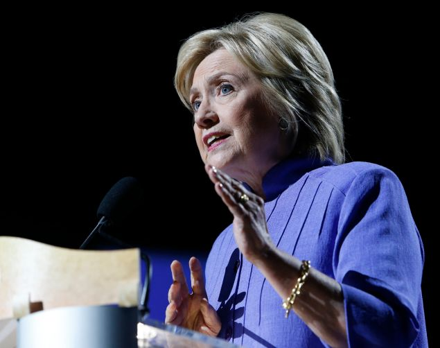 Democratic presidential candidate Hillary Clinton speaks at the NAACP National Convention in Cincinnati, Ohio on July 18, 2016. / AFP / Jay LaPrete